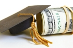 graduation cap and cash roll, closeup